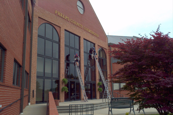 Cleaning windows on the Phelps County Courthouse